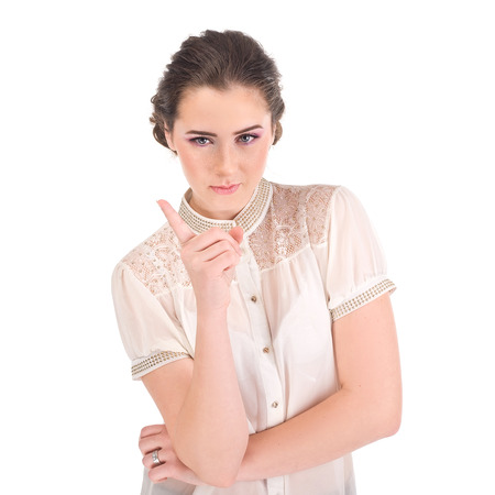 wag: Woman pointing up finger.  Studio shot portrait of one caucasian young woman nanny Stock Photo