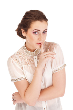 Woman saying be quiet by saying shh photo