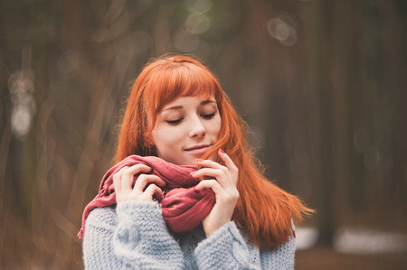 checkered scarf: Hipster. Photo redheaded girl with a scarf. Forest.