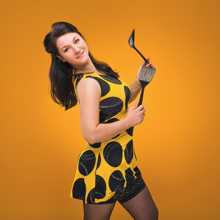 sexy housewife: Pin-Up. Sexy housewife. Vintage. Retro. Brunette in stockings.