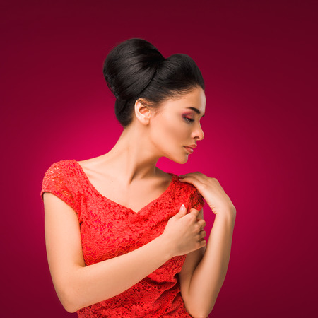 mexican girl: Beauty fashion woman. Beautiful girl in a red dress on a pink background. Stock Photo