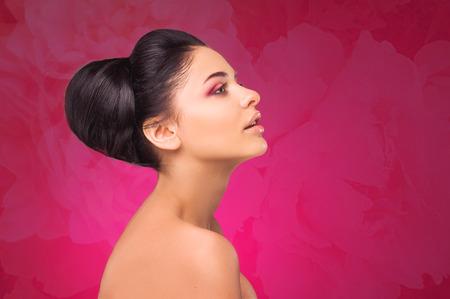 side profile: Profile. Spa. Brunette girl. Floral background.
