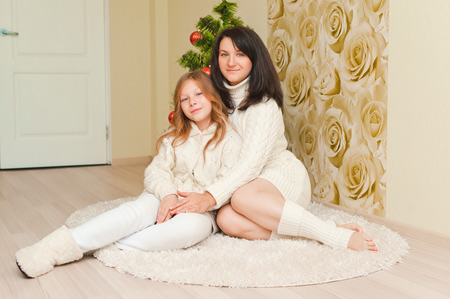 pre teen girls: bright picture of hugging mother and daughter Stock Photo