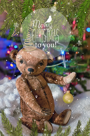 teddy wreath: Christmas card with teddy bear, a Christmas tree, ornaments, gold glitter, fir branches and greeting text. Vintage style. Retro poster.