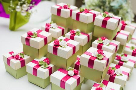 bonbonniere: Small gift on the background of flowers, bonbonniere
