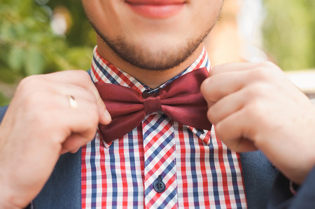 Groom with a red bow tie