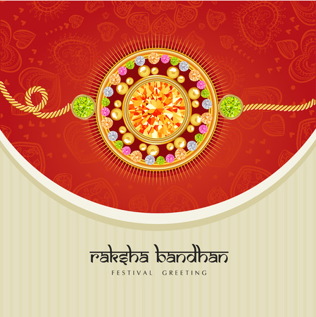 Rakhi with gems on shiny red and beige background for the festival of Raksha Bandhan celebrations.