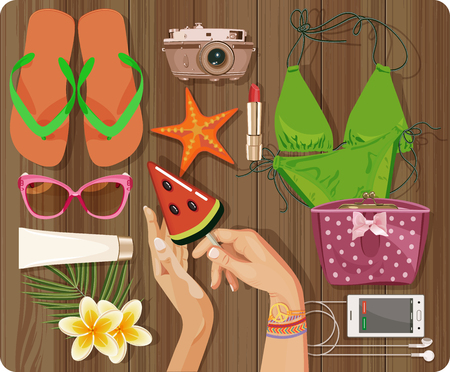 sun cream: Workplace concept. Top view with textured table, swimsuit, starfish, camera, slippers, cosmetic, phone, headphones, sunglasses, sun cream, candy, lollipop, flowers