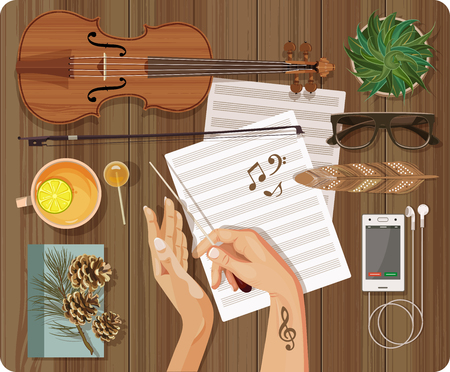 bass: Workplace Music concept. Top view with textured table, feather, violin, bow, music paper, bass clef, treble clef, note, phone, tea, lemon, headphones, music, candy, lollipop, plant, hands