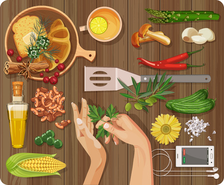 Workplace concept. Top view with textured table, plates, dishes, pepper, garlic, asparagus, mushrooms, berries, green peas, corn, salt, spices, cooking utensils, rolls, croissants, olive oil