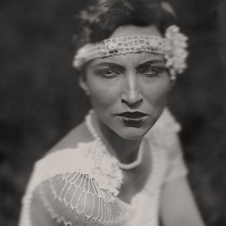 Wet-plate. Collodion photography of young woman in white vintage dress.
