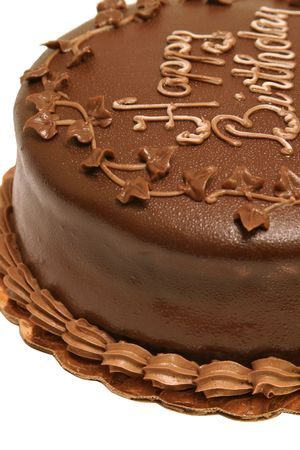 chocolaty: A closeup of a dark chocolate birthday cake.