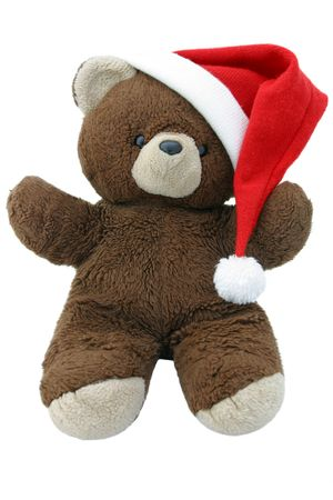 A teddy bear wearing a santa hat.  Straight on view, isolated. photo