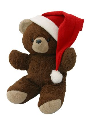 A teddy bear wearing a santa hat. Sitting on an angle and isolated. photo