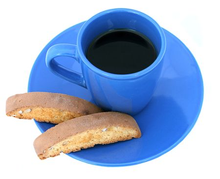 cooky: A blue coffee cup and saucer with biscotti. Stock Photo