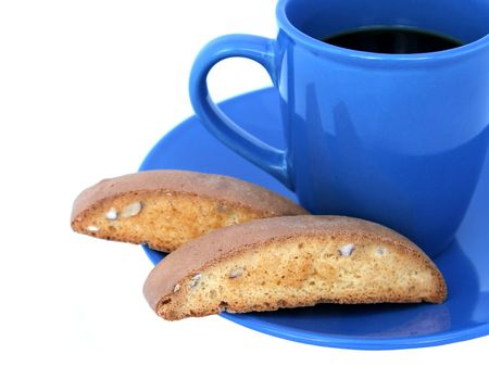 bisquit: Coffee in a blue cup with biscotti on the side.  Isolated.