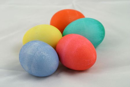 brightly: A group of brightly colored Easter eggs.
