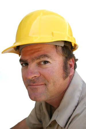 about you: A repairman in a hard hat looking skeptical, like he is about to over charge you. Stock Photo