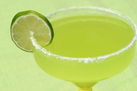 quench: A margarita with a lime against a green background.