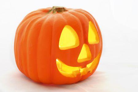 samhain: Un Halloween Jack-O-Linterna de perfil sobre un fondo blanco. Foto de archivo