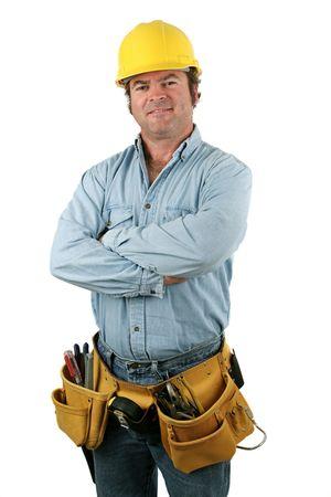 ツール ベルト笑顔で建設労働者。分離されました。