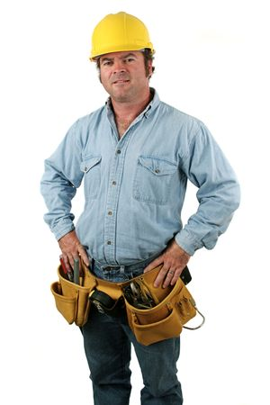 A construction worker posing proudly with hands on hips.  Isolated.