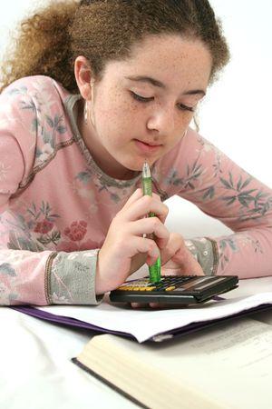 teenaged: A school girl doing math homework.