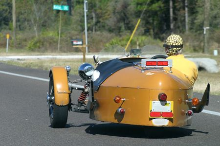 motoring: A man motoring down the road in a custom hot rod. Stock Photo