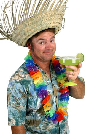 A man in a Hawaiian shirt with a lei and straw hat, holding a margarita. He looks like hes making a toast with it. photo