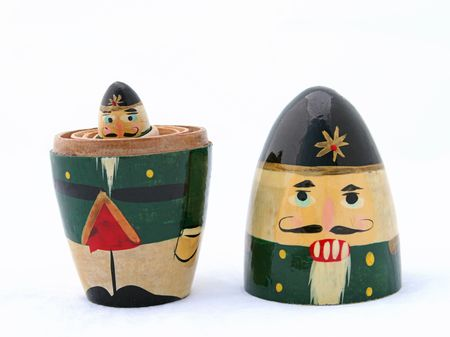 A Russian nesting Christmas nutcracker, taken apart with the littlest one peering out. photo