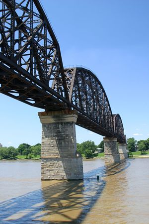 runoff: A vertical view of a railroad bridge over the ohio river from Kentucky to Indiana.