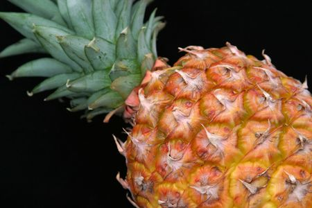 A unique composition of a pineapple against a black background. Imagens