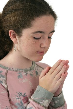 teenaged: A teenaged girl with her hands folded in prayer. Isolated.