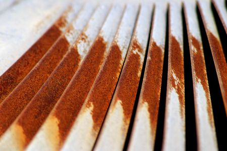 vents: A close-up, abstract view of rusty air conditioner vents. Stock Photo