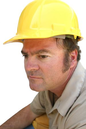 A man in a hard hat, looking seus. Stock Photo - 205964