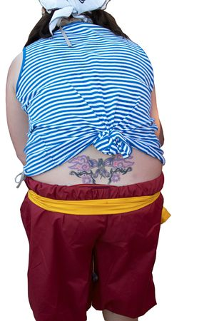 A girl, bending over, with a tattoo visible above her waistband.