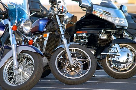 'cycles: three motorcycle lined up in a row. (logos removed) Stock Photo