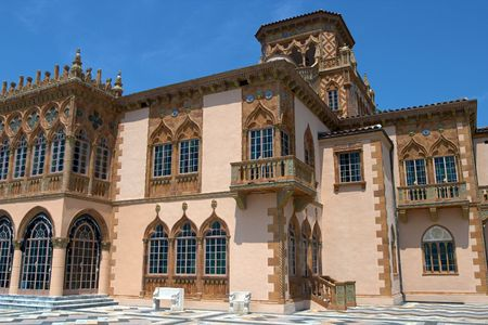 An exterior view of an elegant, venetian-style palazzo.