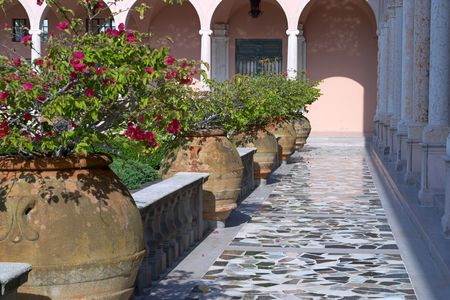 palatial: An elegant courtyard of a venetian-style palazzo with huge pots of bouganvillea.