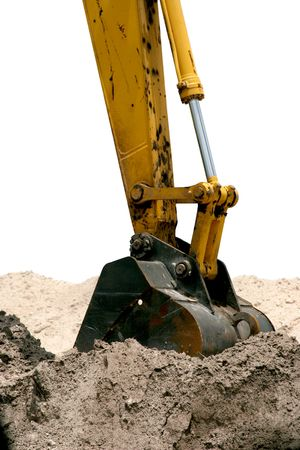 hoe: A back hoe, digging up dirt.  Isolated.