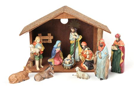 creche: A complete Nativity scene including the holy family, wise men, shepherds & animals with stable.  Isolated. Stock Photo