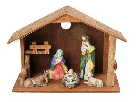 creche: Una escena peque�a de la natividad con la familia y los animales santos en el establo. Aislado.