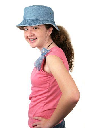 teenaged: A stylish teenaged girl smiling with braces. Three quarter pose, isolated. Stock Photo