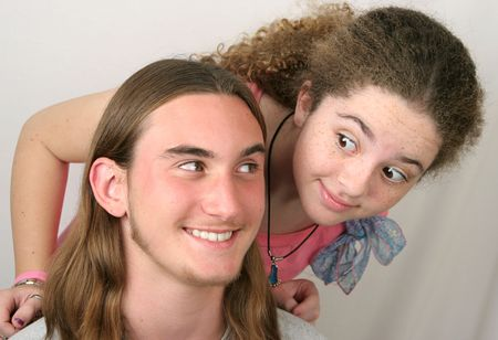 eachother: A cute teenaged couple flirting with eachother. Stock Photo