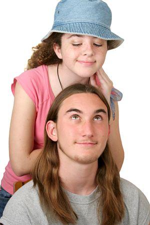 teenaged: A cute teenaged girl flirting with an attractive teenaged boy.  Isolated. Stock Photo