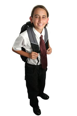 private or public: A boy dressed in his school uniform with his backpack. Fully body view isolated.
