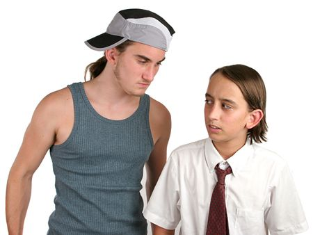 intimidated: A small boy being intimidated by a big bully. Isolated.