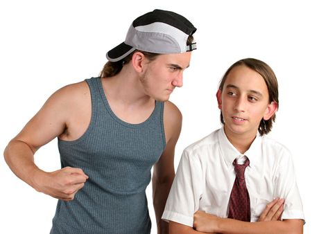 ignoring: A young boy being bothered by a big bully, but he is ignoring him. Isolated. Stock Photo