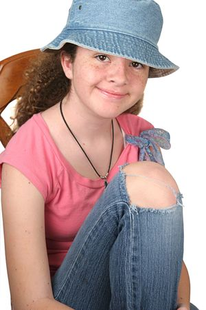 teenaged: a teenaged girl casually dressed with a tear in her jeans.  Isolated. Stock Photo