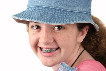 teenaged girls: A closeup of a cute teenaged girl with braces